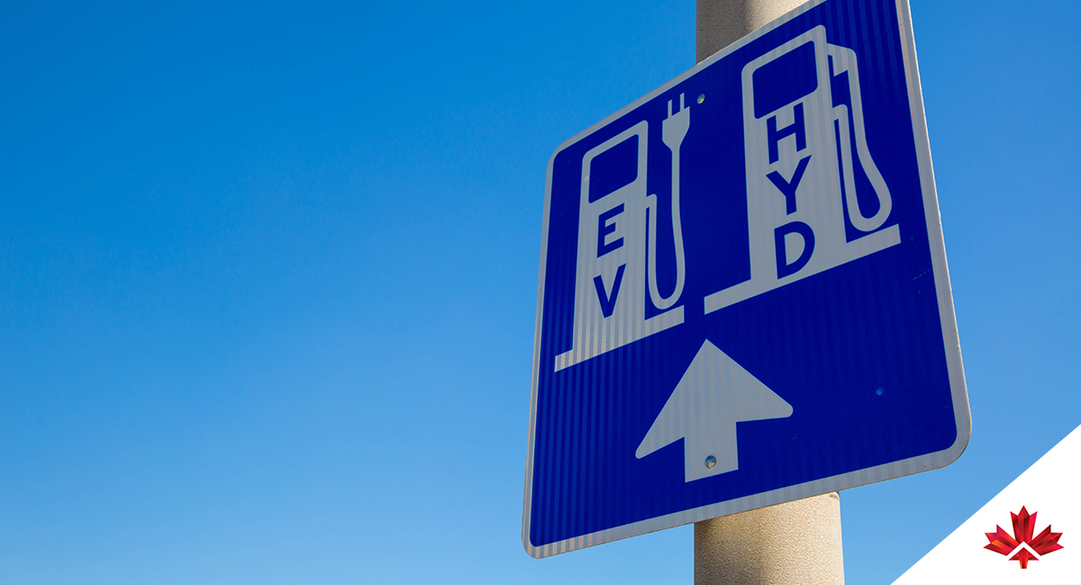 street sign indicating electric and hydrogen stations ahead