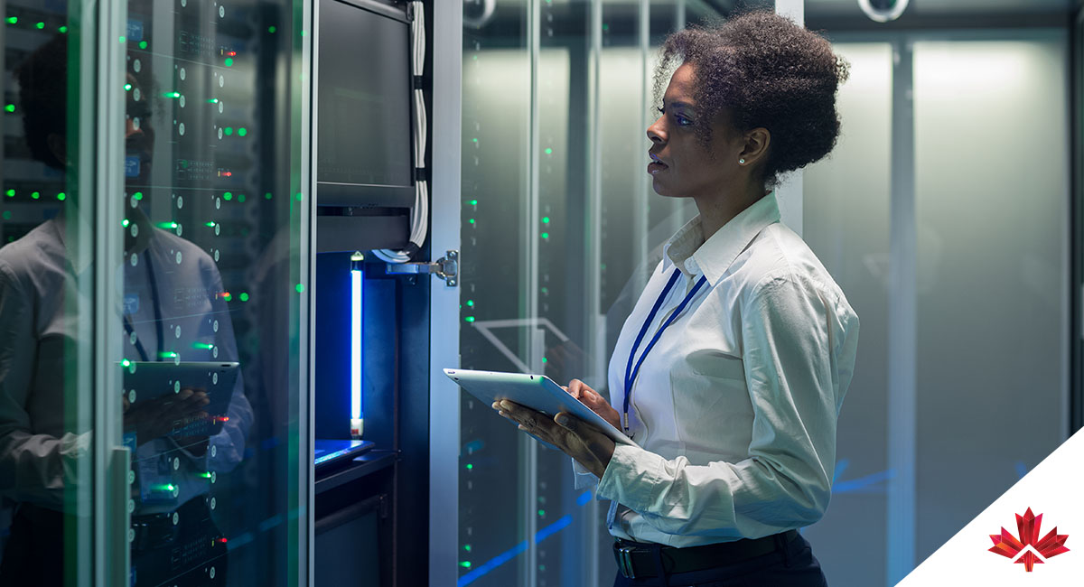 woman using tablet in server room